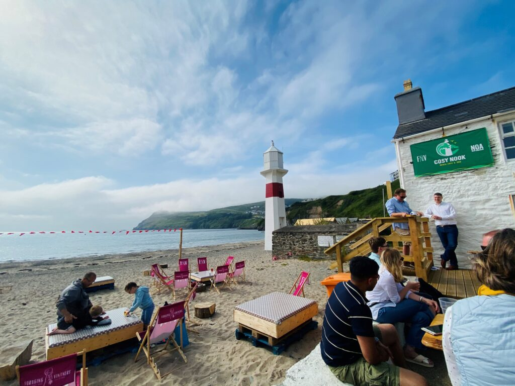 Affinity team relax at a cafe by the beach at Port Erin, Isle of Man